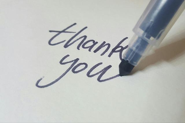 紙にペンでthank youと書かれている画像です。