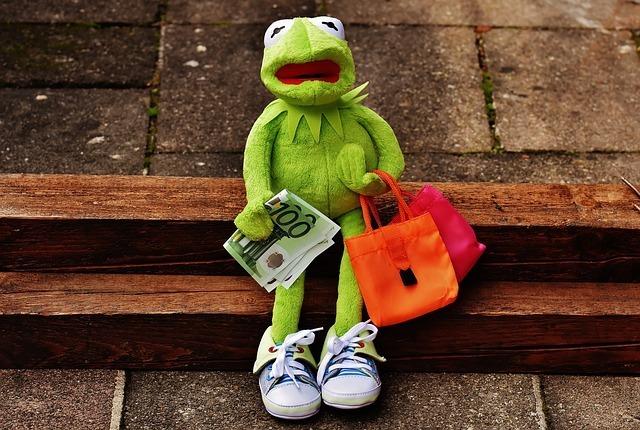 お金を持っているカエル